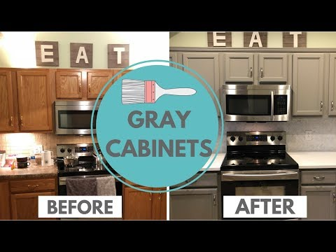 Brown cabinets with grey countertops   Dark wood kitchen